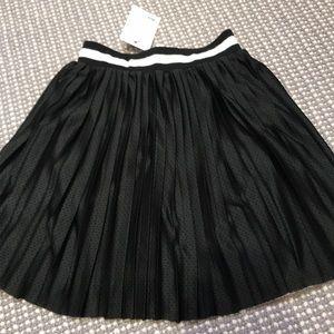 Mini skirt with black and white band. UK 6 US 2